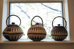 three woven baskets in window